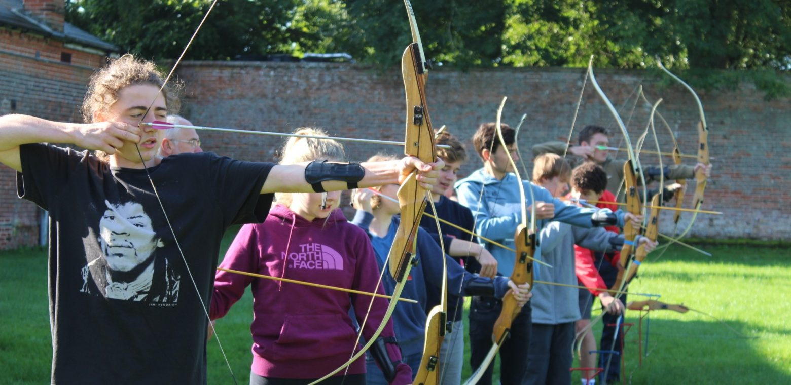 children practising archery