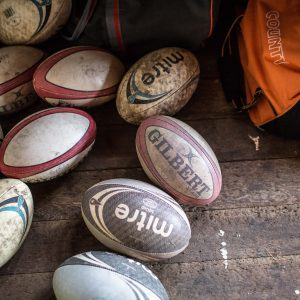 rugby balls and sports bag
