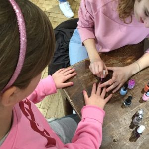 children painting nails