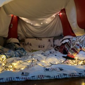 den made from bedding and fairy lights