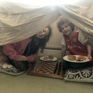 children eating in den with chess