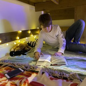 boy reading in bunk bed