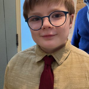 school boy with glasses and tie
