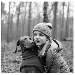 black and white photo of girl and dog