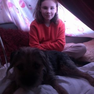 girl and dog in den