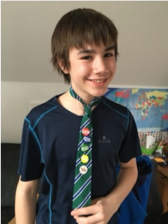 boy with badges on school tie