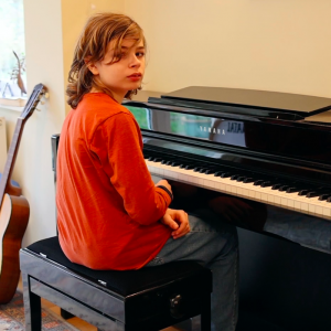 child sitting at a piano
