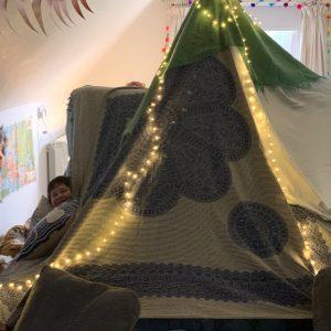 children's den decorated with lights