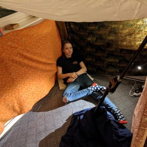 child relaxing in den at home