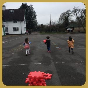 school children playing a game in playground