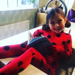 world book day ladybug girl with book