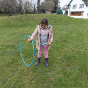 girl with blue hula hoop