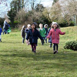 school children walking across school field