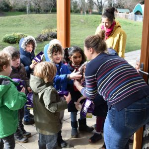 children collecting Easter eggs at school