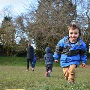 children running in school field