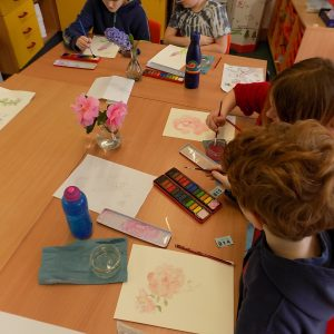 school children painting still life flowers
