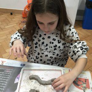 school girl modelling clay