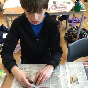 school boy modelling clay