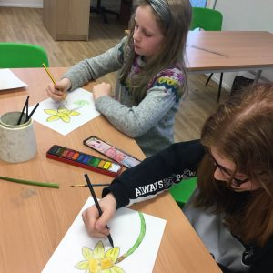 girls drawing daffodils