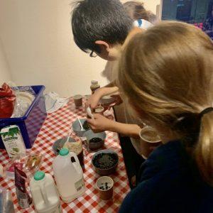 school children making hot chocolate