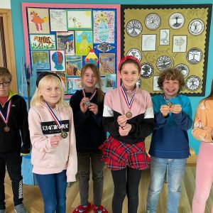 st chris pupils with medals