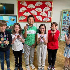 school children with medals