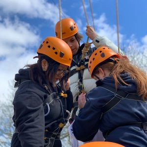 school girls learning how to abseil