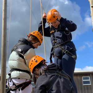 school girls learning to abseil