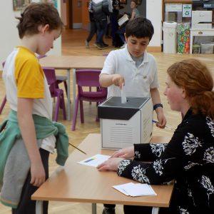 children using a school elections box