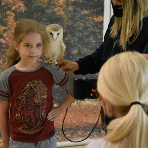 owl on girl's shoulder