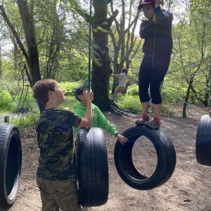 Children on a tyre swing obstacle course