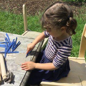 girl making clay model